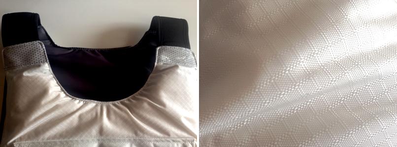 Photographie du tissu du gilet et des bandes réflechissantes