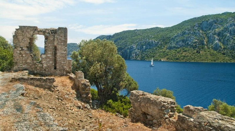view of Aegean sea bay and mountains from ruined 12th century byzantine church wall on Camellia island, Turkey
